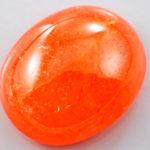 Светло оранжевый кабошон спессартина